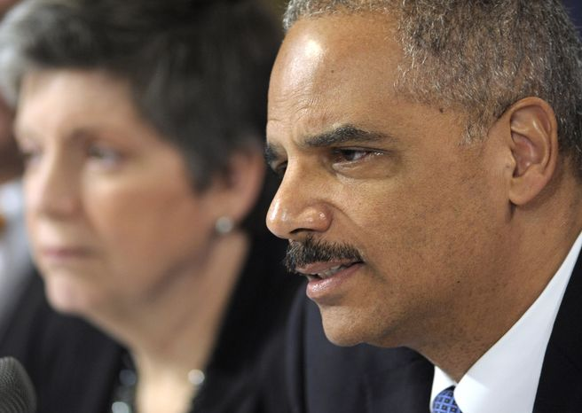 Attorney General Eric Holder, accompanied by Homeland Security Secretary Janet Napolitano, speaks Thursday at the Justice Department in Washington following an U.S.-EU Justice and Home Affairs Ministerial Meeting. (Associated Press)