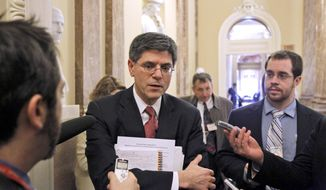 Budget Director Jacob Lew talks with the media on Capitol Hill in Washington, Wednesday, Dec. 8, 2010 after attending the Senate Democratic caucus to discuss President Obama's tax-cut deal with the Republicans. (AP Photo/Alex Brandon)
