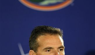 Florida head football coach Urban Meyer announces his resignation during a news conference in Gainesville, Fla., Wednesday, Dec. 8, 2010. (AP Photo/John Raoux)