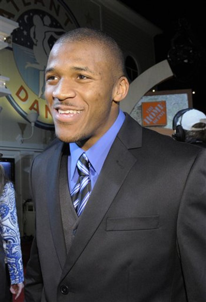 Auburn quarterback Cam Newton joles for photographers after the Home Depot ESPNU College Football Awards in Lake Buena Vista, Fla., Thursday, Dec. 9, 2010.  Newton won the Davey O'Brien Award, given to the best quarterback, and the Maxwell Award, given to the best all-around player. (AP Photo/Phelan M. Ebenhack)
