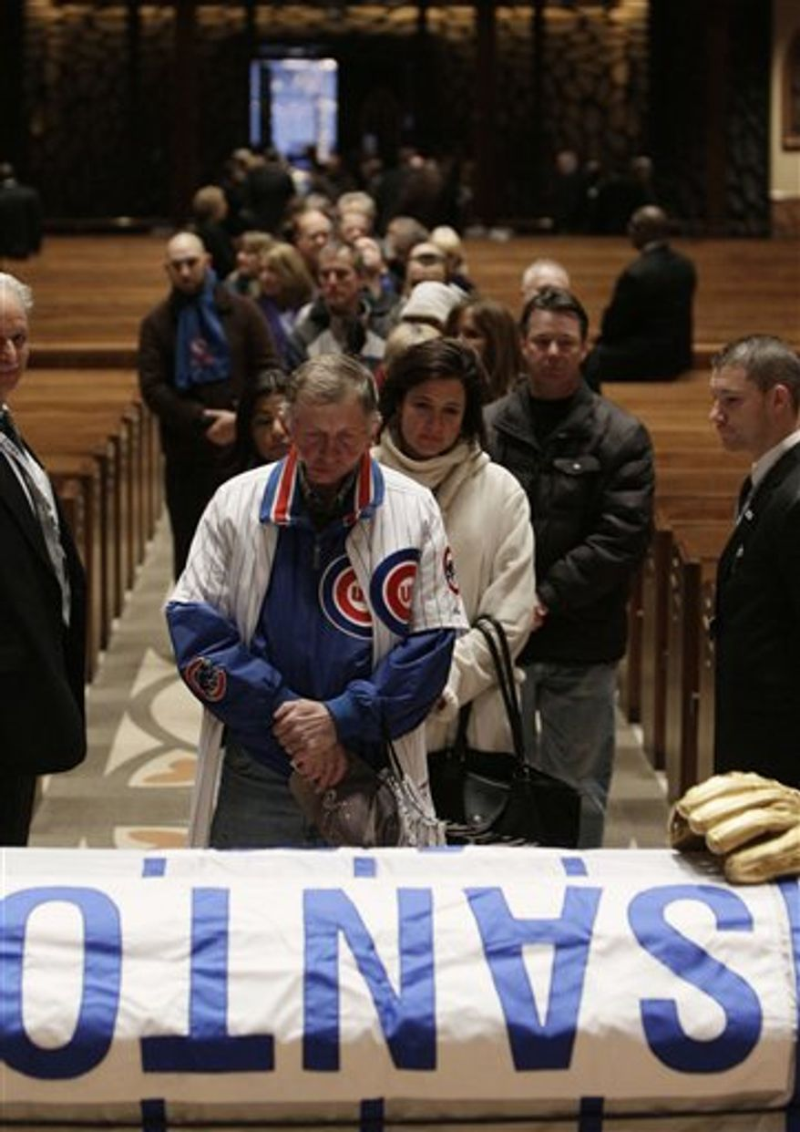 FILE - This is a Feb. 19, 2005, file photo showing former Chicago Cubs star Ron Santo.  Hundreds of fans of Ron Santo are expected to turn out Thursday, Dec. 9, 2010,  to bid farewell at the wake of the Chicago Cubs star who spent 20 years broadcasting games of his former team. (AP Photo/Morry Gash, File)
