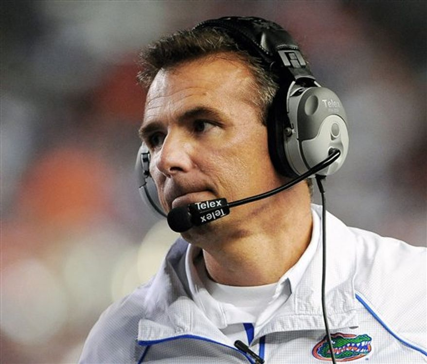 Florida head football coach Urban Meyer announces his resignation during a news conference in Gainesville, Fla., Wednesday, Dec. 8, 2010.(AP Photo/John Raoux)