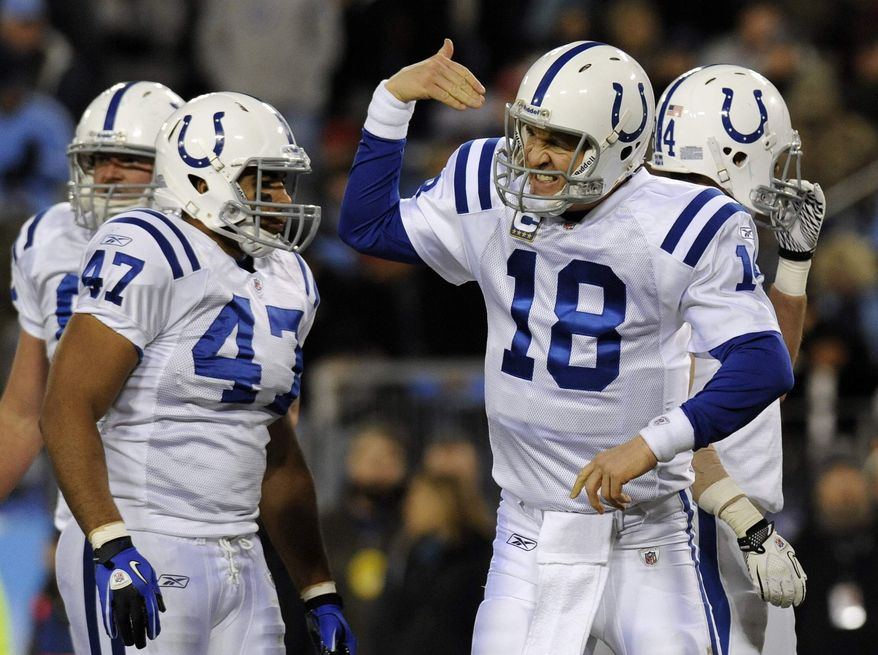 Indianapolis Colts quarterback Peyton Manning (18) calls a teammate to the huddle in the second quarter of an NFL football game against the Tennessee Titans on Thursday, Dec. 9, 2010, in Nashville, Tenn. At left is tight end Gijon Robinson (47). (AP Photo/Joe Howell)