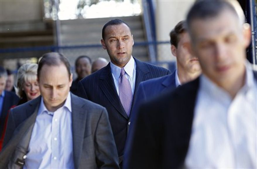 From left, New York Yankees general manager Brian Cashman, shortstop Derek Jeter, managing general partner Hal Steinbrenner and manager Joe Girardi make their way to a press conference  Tuesday, Dec. 7, 2010 George M. Steinbrenner Field in Tampa,  to announce  Jeter signing  his $51 million, three-year contract.(AP Photo/Brian Blanco)