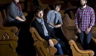 This Dec. 8, 2010 picture shows members of the band Jars of Clay, Dan Haseltine, left, Matt Odmark, Charlie Lowell, and Stephen Mason, at the Ryman Auditorium in Nashville, Tenn. The group recently met their goal of providing clean water to 1,000 African communities through the organization they founded, Blood:Water Mission, and its 1,000 Wells Project. They're celebrating the milestone with a benefit concert at Nashville's Ryman Auditorium on May 10. (AP Photo/Josh Anderson)