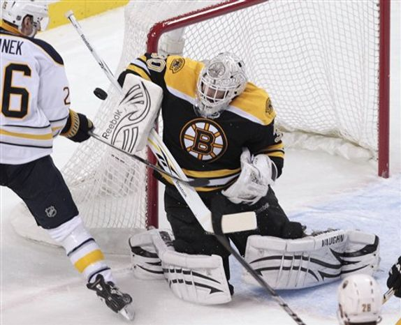 In this photo taken Tuesday, Dec. 7, 2010, Boston Bruins goalie Tim Thomas rolls onto his back after making a save against the Buffalo Sabres during the first period of an NHL hockey game in Boston Last year, Thomas was relegated to the bench by not only the U.S. Olympic team, but his very own Boston Bruins. Again the starter in Boston, Thomas is having the best season of any goalie in the league so far, and his efforts show in the standings, as the resurgent Bruins try to wipe away the nightmare that was blowing a 3-0 playoff series lead to Philadelphia last season.(AP Photo/Charles Krupa)