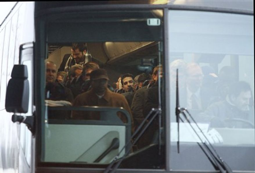 New York Giants spokesperson Pat Hanlon walks to a bus as the team leaves Kansas City International Airport, Saturday, Dec. 11, 2010, in Kansas City, Mo. The teams' plane was diverted to Kansas City after the plane could not make it to Minneapolis due to weather.  (AP Photo/Ed Zurga)