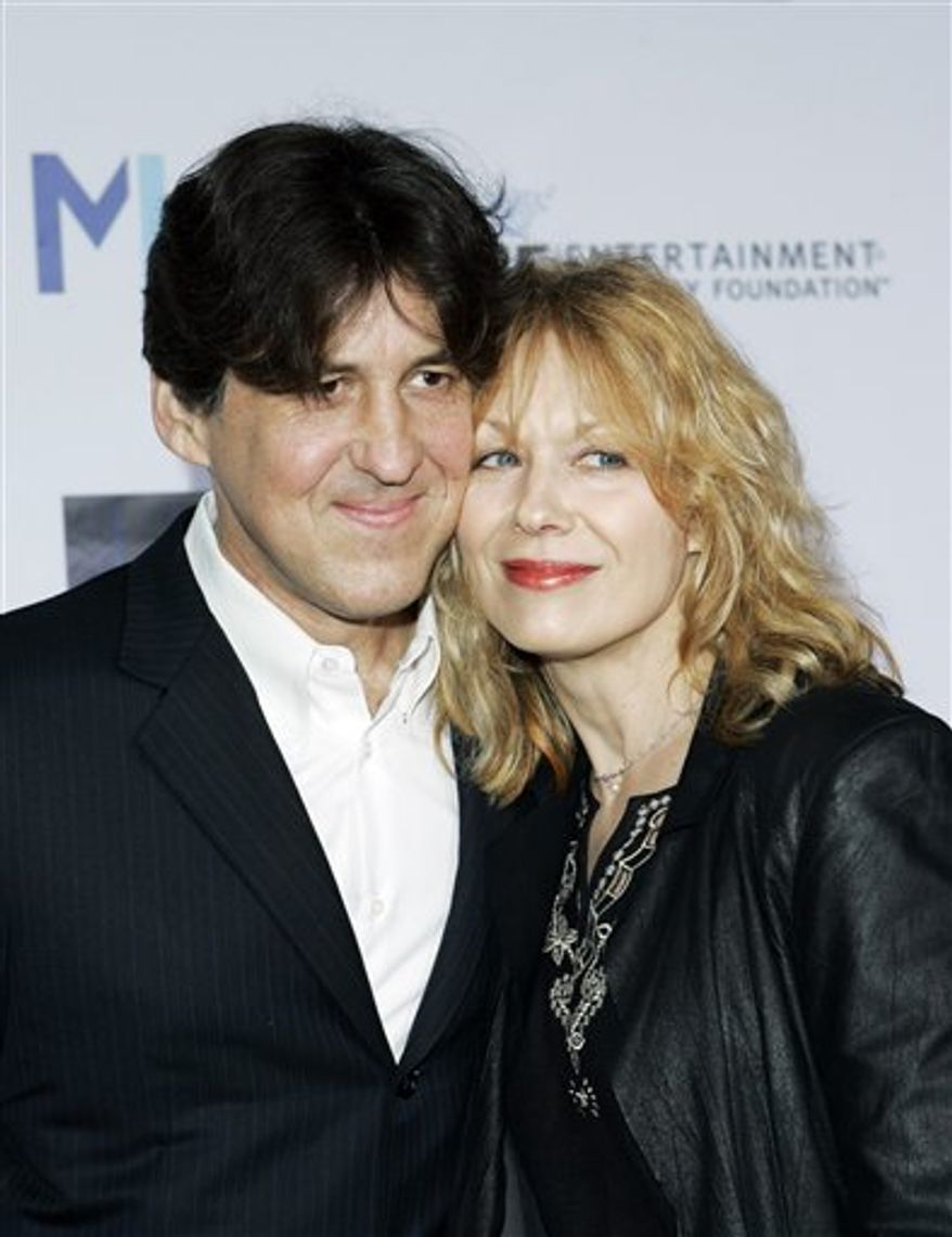 FILE - In this March 22, 2007 file photo, director Cameron Crowe and his wife Nancy Wilson arrive at Mentor LA's Promise Gala honoring Tom Cruise for his commitment to the welfare of LA's youth in Los Angeles. (AP Photo/Kevork Djansezian, file)