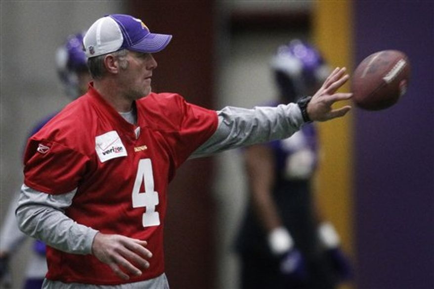 Minnesota Vikings quarterback Brett Favre tosses the football with his left hand during practice, Thursday, Dec. 9, 2010, at Winter Park in Eden Prairie, Minn. Favre was on the field Thursday during the portion of practice open to the media, but was not throwing because of a sprained throwing shoulder. (AP Photo/The Star Tribune, Jerry Holt)