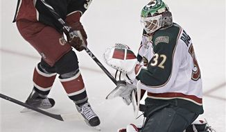 Minnesota Wild goalie Niklas Backstrom (32) stops a shot on goal by Phoenix Coyotes' Vernon Fiddler (38) during the first period of an NHL hockey game, Thursday, Dec. 9, 2010, in Glendale, Ariz. (AP Photo/Matt York)