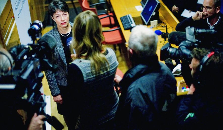 Marianne Ny (back left), Swedish director of public prosecution, answers questions at police headquarters in Gothenburg, Sweden, on Tuesday. She said in a statement that she had moved to have Mr. Assange extradited to Sweden on suspicion of rape, sexual molestation and unlawful coercion. (Associated Press)