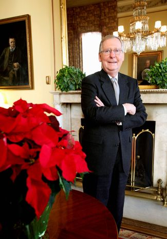 Senate Minority Leader Mitch McConnell, Kentucky Republican, poses in his office on Capitol Hill on Thursday. The midterm elections, which gave the GOP more seats in the Senate, strengthened Mr. McConnell's hand in dealing with the president. (Associated Press)