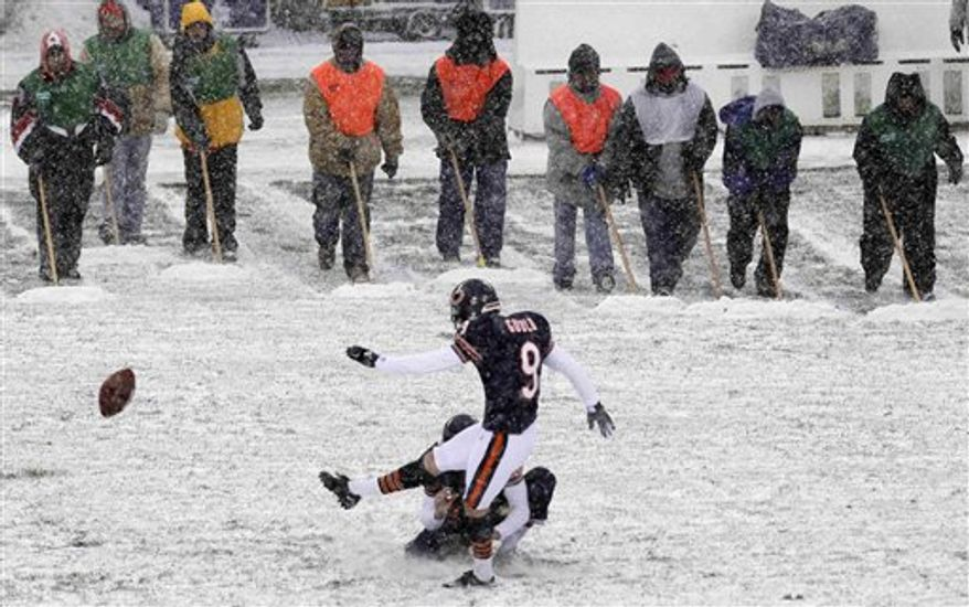Chicago Bears placekicker Robbie Gould (9) practices field goals as workers at Soldier Field wait to clear snow from the field before an NFL football game against the New England Patriots in Chicago, Sunday, Dec. 12, 2010. (AP Photo/Charles Rex Arbogast)