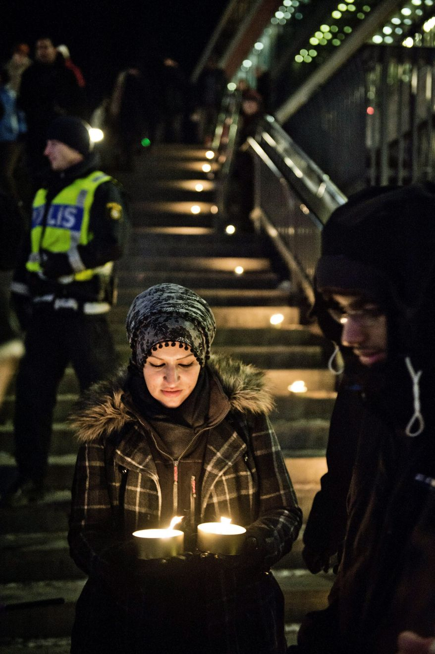 Sama Sarsour, with Swedish Muslims for Peace and Justice, demonstrates for peace in Stockholm on Sunday. Swedish police said two blasts Saturday in the city were terrorism. (Associated Press)