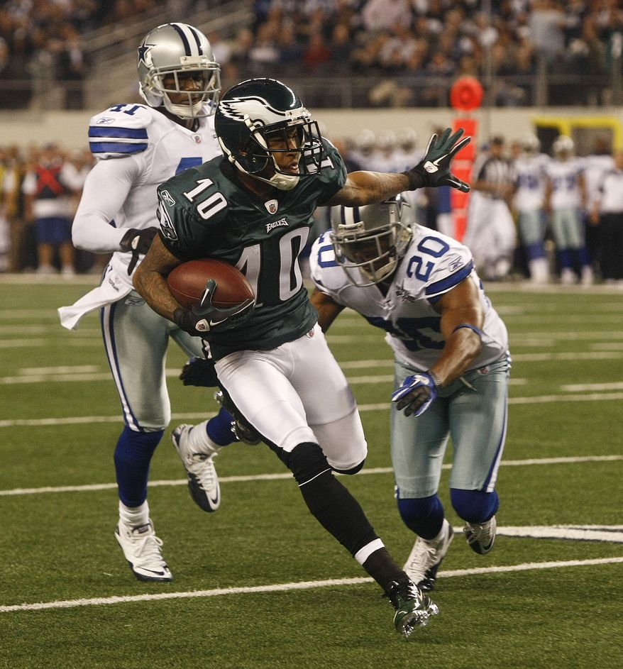 Philadelphia Eagles wide receiver DeSean Jackson (10) is tackled by Dallas Cowboys cornerback Alan Ball (20) and Terence Newman (41) after catching a 60-yard pass in the first half of the Eagles' 30-27 win on Sunday in Arlington, Texas. (Associated Press)