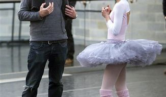 """In this undated film publicity image released by Fox Searchlight, director Darren Aronofsky, left, and Natalie Portman are shown during the filming of """"Black Swan."""" The Broadcast Film Critics Asociation (BFCA) gave the film 12 nominations, more than any other movie, for the Critics' Choice Movie Awards.    (AP Photo/Fox Searchlight, Niko Tavernise)"""