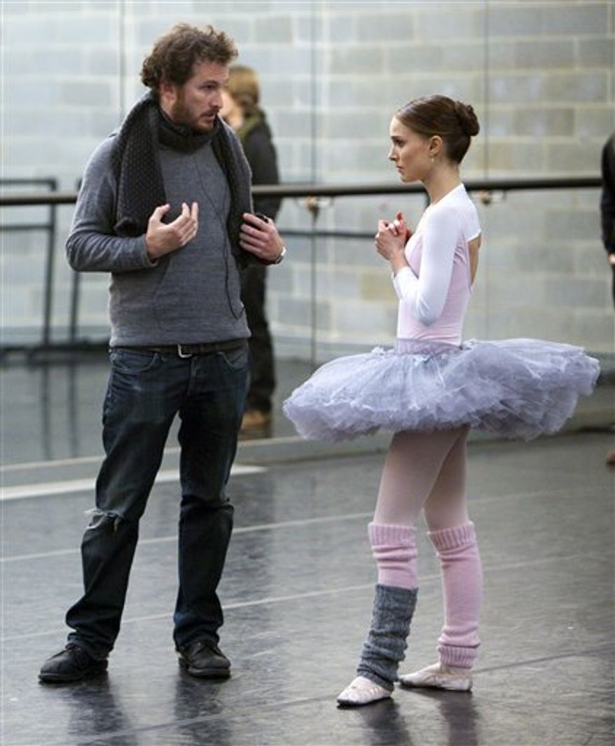 "In this undated film publicity image released by Fox Searchlight, director Darren Aronofsky, left, and Natalie Portman are shown during the filming of ""Black Swan."" The Broadcast Film Critics Asociation (BFCA) gave the film 12 nominations, more than any other movie, for the Critics' Choice Movie Awards.    (AP Photo/Fox Searchlight, Niko Tavernise)"