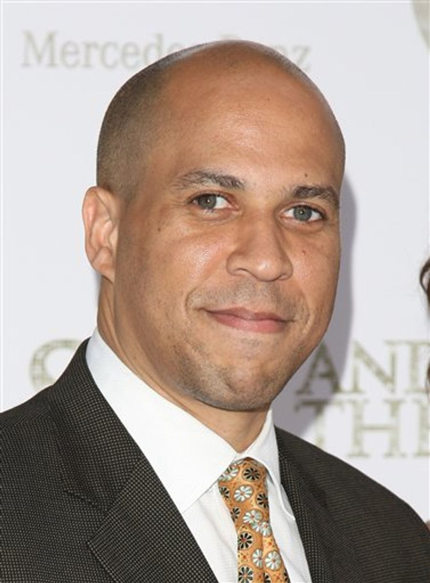 "FILE - In this May 24, 2010 file photo, Cory Booker attends a premiere in New York. The six-part series ""Brick City,"" an award-winning documentary set in Newark, will be shown on the Sundance Channel. (AP Photo/Peter Kramer, File)"