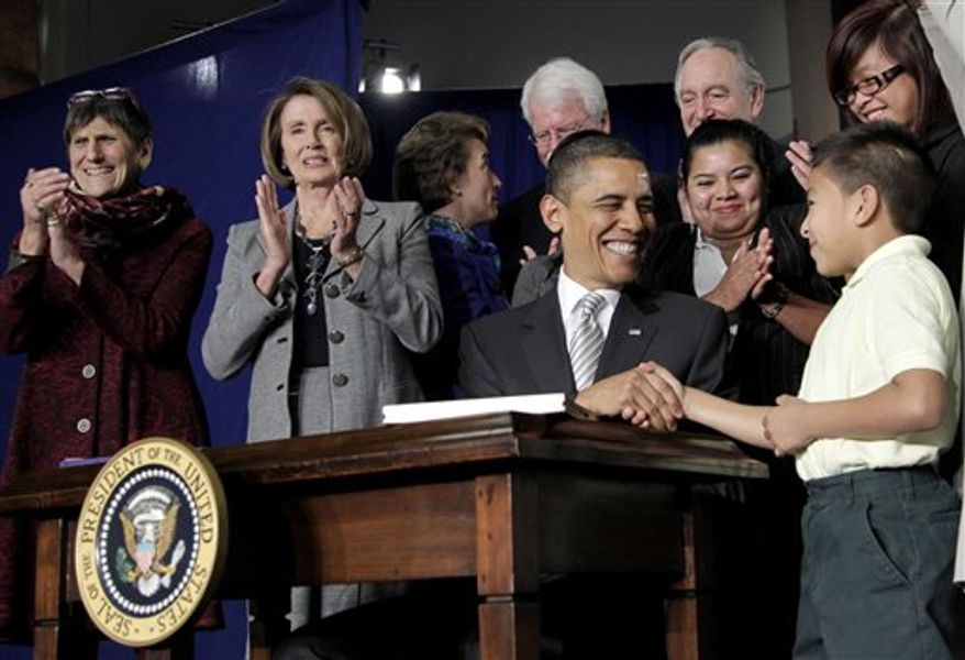 President Obama shakes hands with third-grader Luis Avilar-Turcios, 8, after signing the Healthy, Hunger-Free Act of 2010 during a ceremony at the Harriet Tubman Elementary School in Washington's Columbia Heights neighborhood on Monday, Dec. 13, 2010. Rep. Rosa DeLauro (left), Connecticut Democrat, and House Speaker Nancy Pelosi, California Democrat, were among the dignitaries applauding the signing. (AP Photo/Pablo Martinez Monsivais)