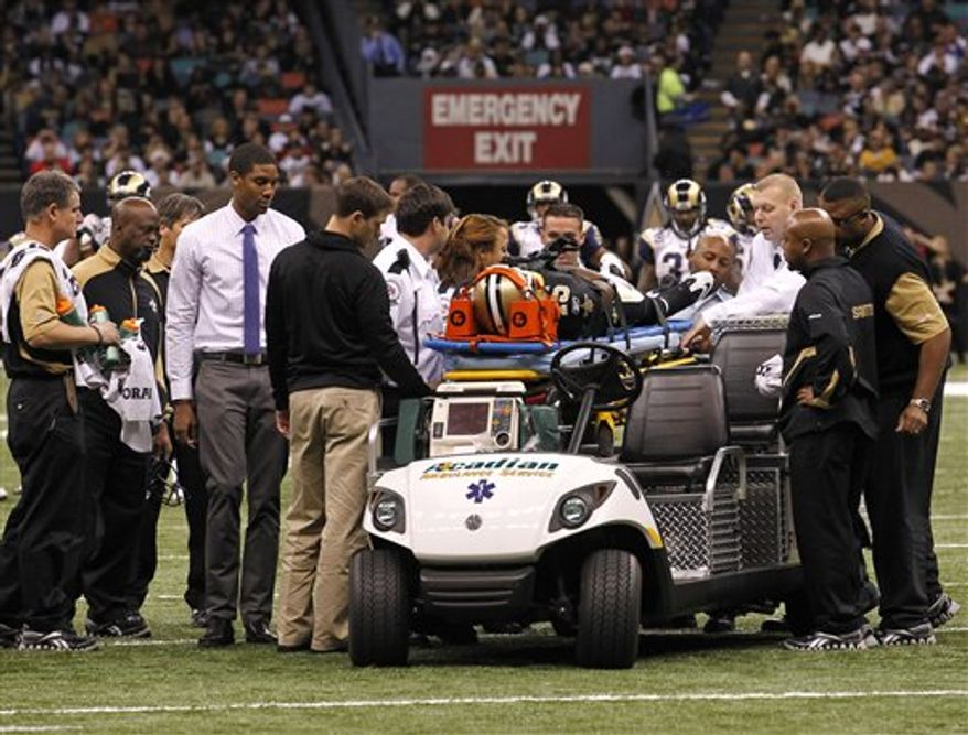 New Orleans Saints wide receiver Courtney Roby is placed on a stretched after injuring himself during a play against the St. Louis Rams in the first half of an NFL football game at the Louisiana Superdome in New Orleans, Sunday, Dec. 12, 2010. (AP Photo/Gerald Herbert)