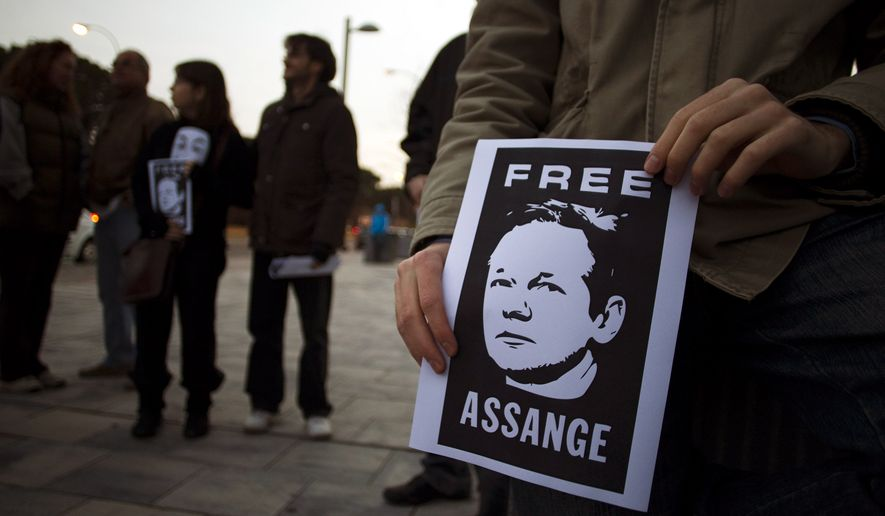 Supporters of WikiLeaks founder Julian Assange hold posters with his photo during a protest in front of the British Embassy in Madrid on Saturday, Dec. 11, 2010. (AP Photo )
