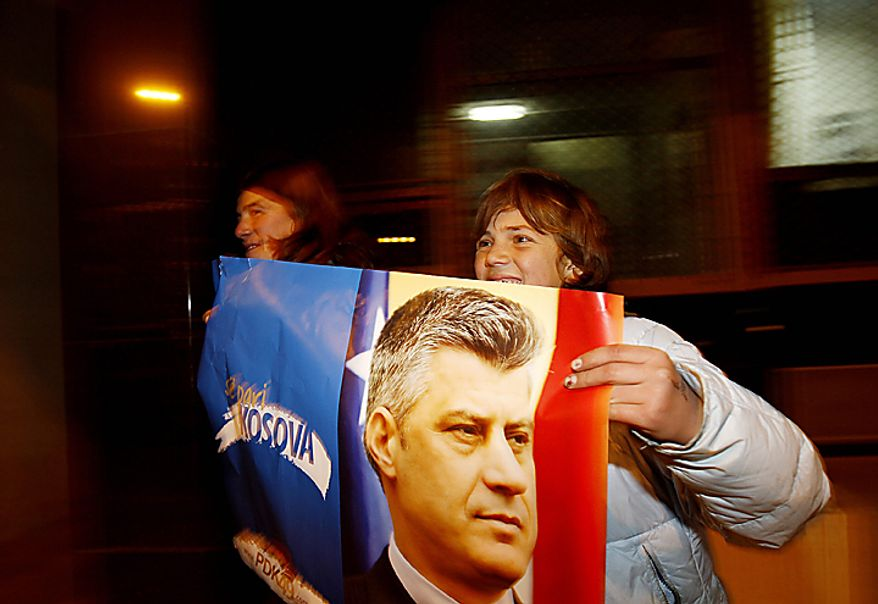 Supporters of the Democratic Party of Kosovo (PDK) celebrate the party's victory in Pristina, Kosovo, on Sunday, Dec. 12, 2010. Incumbent Prime Minister Hashim Thaci, seen in photo on poster, claimed victory Sunday in Kosovo's first general election since the province declared independence from Serbia, as an independent exit poll showed his Democratic Party of Kosovo 6 percentage points ahead of its rivals.  (AP Photo/Visar Kryeziu)