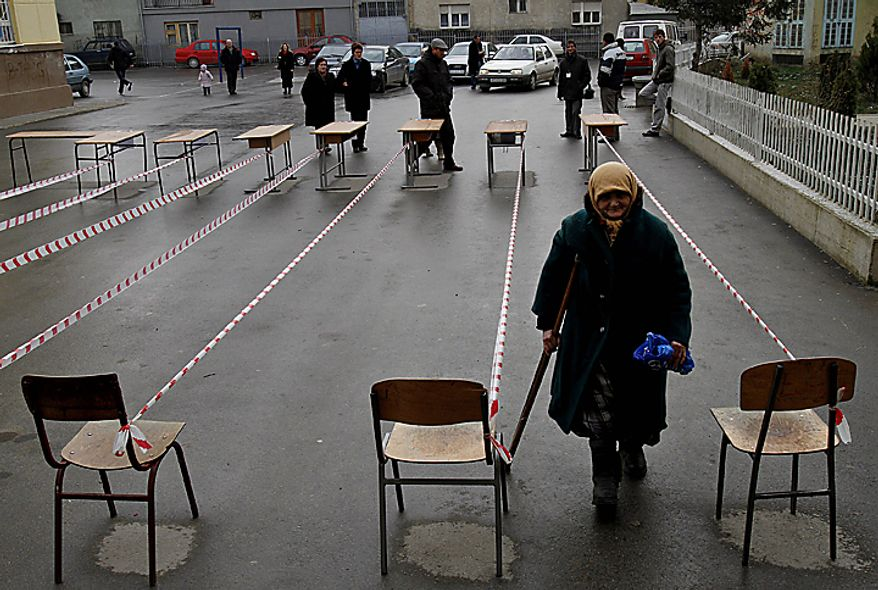 A Kosovo woman arrives at a polling station to cast her ballot in general elections in Kosovo's capital Pristina on Sunday, Dec. 12, 2010. Kosovars vote in the first general poll since the country's declaration of independence from Serbia in 2008, a critical election already marred by ethnic tension that many fear will split the world's newest country.  (AP Photo/Visar Kryeziu)