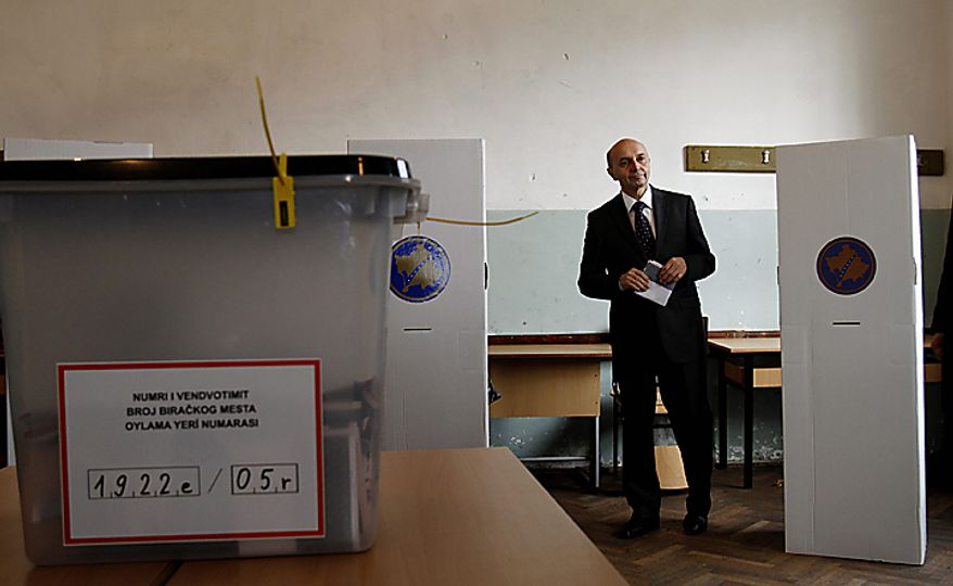 Leader of Democratic League of Kosovo (LDK) Isa Mustafa, casts his ballot in general elections in Kosovo capital Pristina on Sunday, Dec. 12, 2010. Kosovars vote in the first general poll since the country's declaration of independence from Serbia in 2008, a critical election already marred by ethnic tension that many fear will split the world's newest country. Some 1.6 million voters are eligible to vote for 29 political parties, coalitions and citizens' initiatives to enter Kosovo's 120-seat parliament. (AP Photo/Visar Kryeziu)