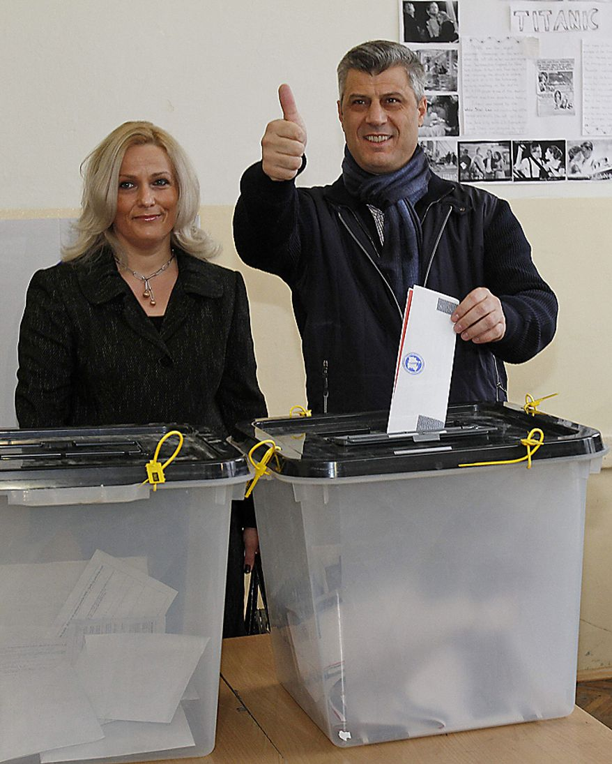 Leader of Democratic Party of Kosovo, PDK, Hashim Thaci joined by his wife Lumnije, gives a thumbs up as he casts his ballot in general elections in Kosovo's capital Pristina on Sunday, Dec. 12, 2010. Kosovars vote in the first general poll since the country's declaration of independence from Serbia in 2008, a critical election already marred by ethnic tension that many fear will split the world's newest country.(AP Photo/Visar Kryeziu)