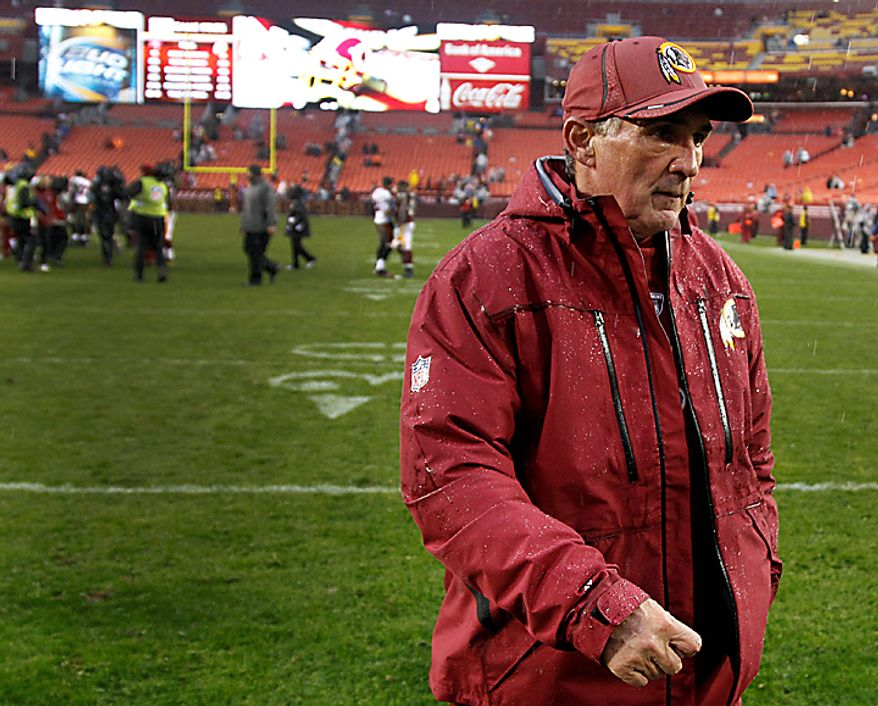 Washington Redskins head coach Mike Shanahan walks off the field after an NFL football game against the Tampa Bay Buccaneers in Landover, Md., Sunday, Dec. 12, 2010. Tampa Bay defeated Redskins 17-16. (AP Photo/Evan Vucci)