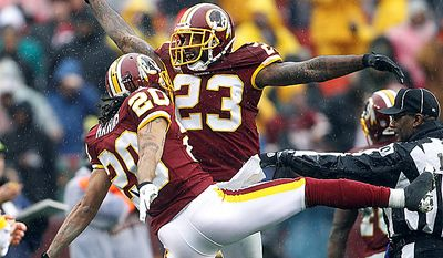 Washington Redskins cornerback DeAngelo Hall (23) celebrates his fumble recovery with teammate cornerback Macho Harris (20) during the first half of an NFL football game against the Tampa Bay Buccaneers in Landover, Md., Sunday, Dec. 12, 2010. (AP Photo/Evan Vucci)
