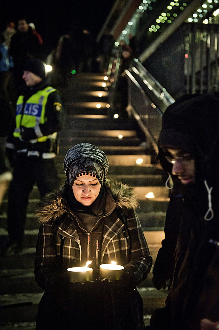 Sama Sarsour from Swedish Muslims for Peace and Justice (SMFR) participates in a peace demonstration at Sergels square in central Stockholm Sunday Dec. 12, 2010 .   Swedish police said Sunday that two explosions in central Stockholm were an act of terrorism, in what appeared to be the first attack in the Nordic country by a suicide bomber. The suspect, who was not named, killed himself and injured two people on a busy shopping street Saturday.   (AP photo/Scanpix Sweden/Marc Femenia)