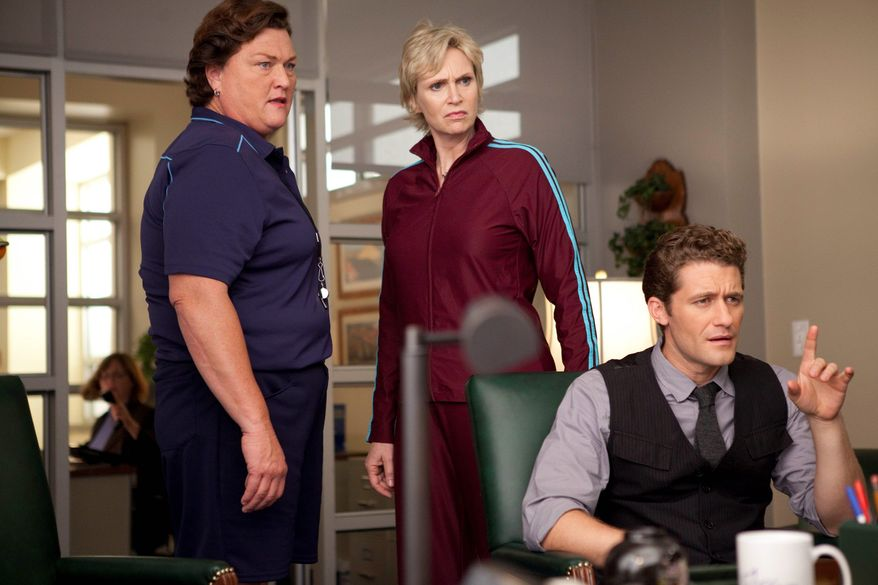 """Dot Jones, Jane Lynch and Matthew Morrison are shown in a scene from """"Glee."""" The program was nominated for a Golden Globe for best television series in the comedy or musical category on Tuesday. Miss Lynch and Mr. Morrison were nominated for acting honors, along with the show's Lea Michele and Chris Colfer. (Associated Press)"""