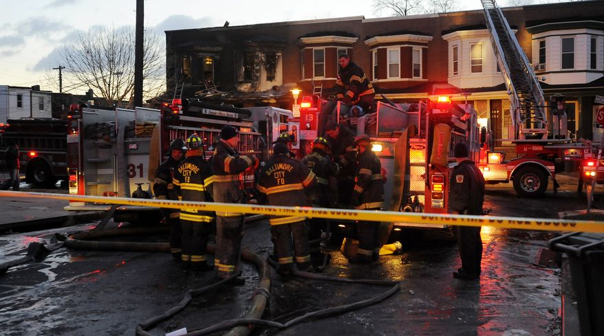 Six people are dead after an early-morning two-alarm fire in the 2300 block of Homewood Avenue in Baltimore on Tuesday, Dec. 14, 2010. (AP Photo/Baltimore Sun, Kim Hairston)