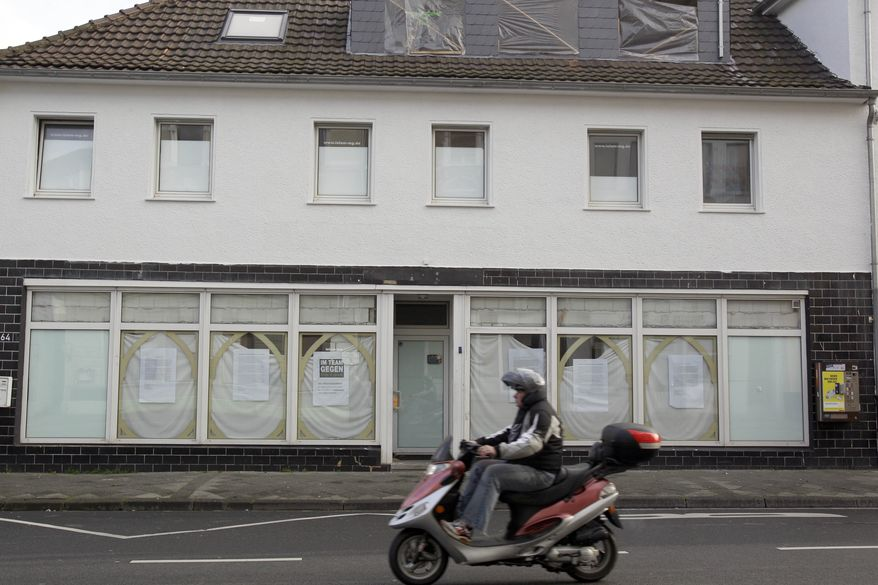 This Nov. 18, 2010, file picture shows the Masjid As-Sunnah mosque, the home of the Invitation to Paradise association in Moenchengladbach, western Germany. The German Interior Ministry said Tuesday, Dec. 14, 2010, that authorities have searched buildings connected to the two groups Islamist groups Invitation to Paradise and Islamic Culture Center Bremen in three cities early Tuesday. (AP Photo/Frank Augstein, File)