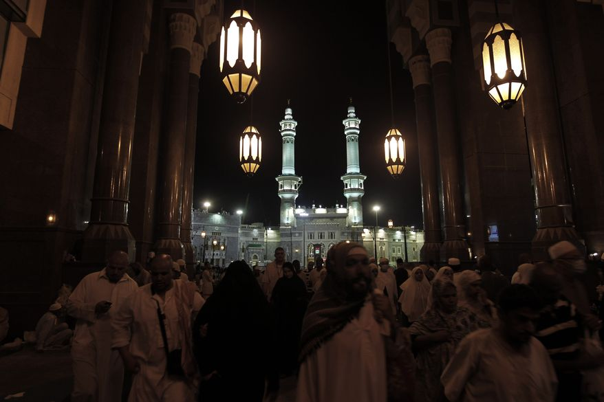 Muslim pilgrims leaving the Grand Mosque after a prayer, during the annual Hajj in Mecca, Saudi Arabia, Thursday, Nov. 18, 2010. The U.S. government sued a suburban Chicago school district on Monday, Dec. 13, 2010, for denying a Muslim teacher leave to go on the pilgrimage. (AP Photo/Hassan Ammar)