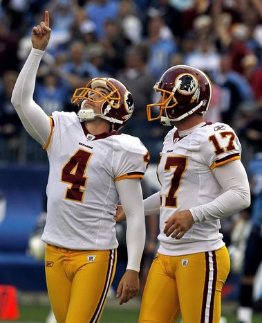 Washington Redskins place kicker Graham Gano (4) celebrates with holder Hunter Smith (17) after booting a 48-yard field goal in overtime to give the Redskins a 19-16 win over the Tennessee Titans in an NFL football game on Sunday, Nov. 21, 2010, in Nashville, Tenn. (AP Photo/Mark Humphrey)