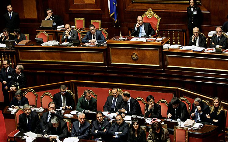 A view of the Italian Senate hall during a parliament debate, in Rome, Tuesday, Dec. 14, 2010. Premier Silvio Berlusconi has survived a confidence vote in the Italian Senate, but another, riskier vote follows in the lower house. Berlusconi had been expected to win the Senate vote on a motion in support of the government that had been brought by his allies. The vote Tuesday was 162-135. The showdown in parliament follows a dramatic fallout with his one-time closest ally, Gianfranco Fini. The breakup potentially deprives Berlusconi of a majority in the lower house, and that vote later Tuesday will hang on a few undecided lawmakers. (AP Photo/Riccardo De Luca)