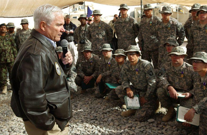 Associated Press Defense Secretary Robert M. Gates addresses U.S. troops while visiting Forward Operating Base Howz-E-Madad in Afghanistan's Kandahar province on Dec. 8.