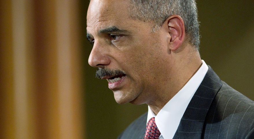 ASSOCIATED PRESS SPILL SALVO: Attorney General Eric H. Holder Jr. announces a lawsuit against BP PLC on Wednesday. The Justice Department accuses the company of failing to take proper safety precautions.