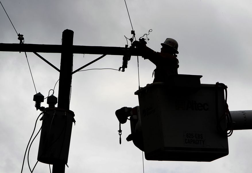 A Duke Energy worker repairs a line after storm damage in Vale, N.C., on Oct. 27, 2010. Energy costs were up 0.2 percent in November, the fifth straight monthly rise, but that still was the smallest increase in five months. (AP Photo/Chuck Burton)