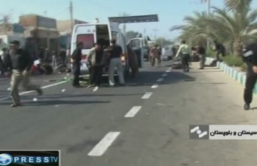 In an image taken from TV, an ambulance attends the scene of a bomb blast in Chahbahar, Iran, on Wednesday, Dec. 15, 2010. Two suicide bombers blew themselves up near a mosque in the southeastern Iranian city near the Pakistan border, and the explosions killed at least of 38 people at a Shi'ite mourning ceremony, state media reported. (AP Photo/Press TV)