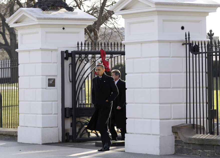 President Obama walks out the White House in Washington, Wednesday, Dec. 15, 2010, and across Pennsylvania Ave., to the Blair House, for a scheduled working meeting with business leaders. (AP Photo)