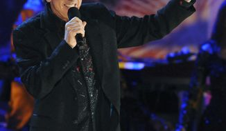 ** FILE ** Neil Diamond performs with the Boston Pops on the Esplanade in Boston in July 2009. The 2011 class for the Rock and Roll Hall of Fame comprises Mr. Diamond, Alice Cooper, Darlene Love, Dr. John and Tom Waits. (AP Photo/Lisa Poole, File)