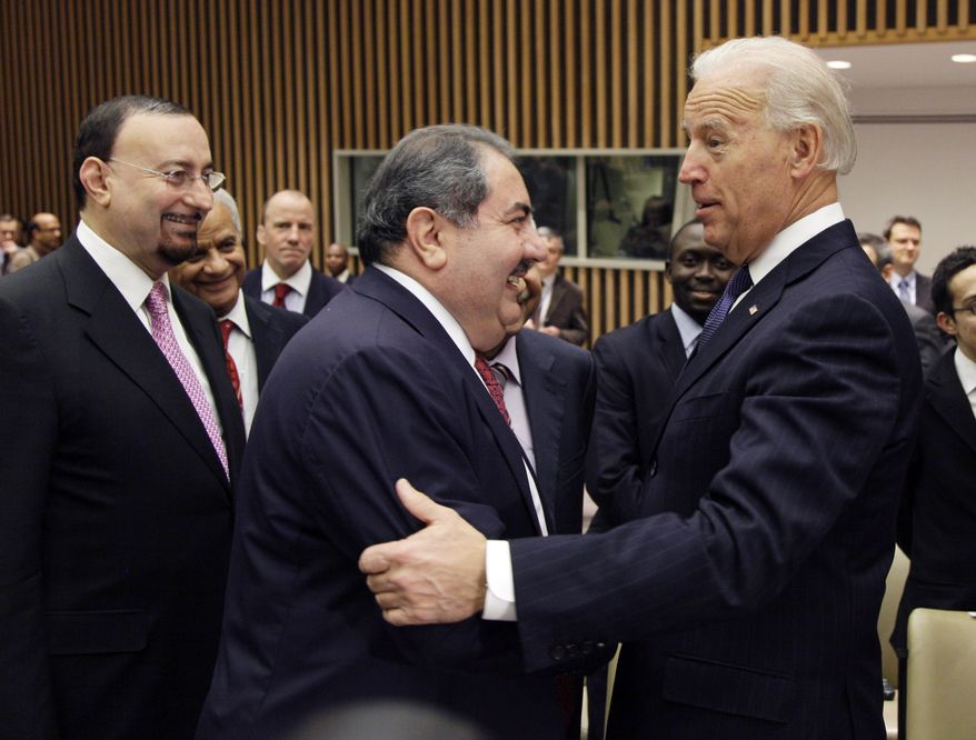 Vice President Joseph R. Biden Jr. (right) greets Iraqi Foreign Minister Hoshyar Zebari (center) before a meeting of the U.N. Security Council at the world body's headquarters in New York on Wednesday, Dec. 15, 2010. At left is Hamid al-Bayati, Iraq's U.N. ambassador. (AP Photo)