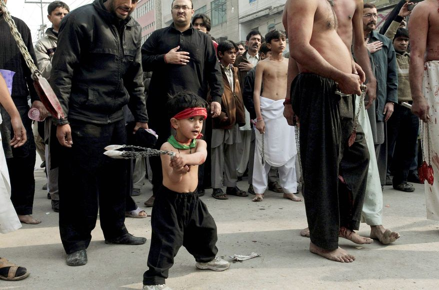 A Shiite child beats himself with bladed chains while participating in a procession in Peshawar, Pakistan. The first month of the Islamic calendar is dedicated to mourning Imam Hussein.
