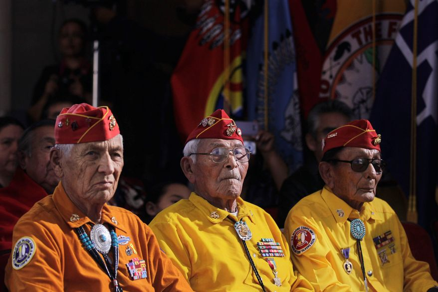 Associated Press World War II-era Navajo Code Talkers listen to President Obama speak Thursday at the White House Tribal Nations Conference, which was attended by representatives of the nation's 565 recognized American Indian tribes.