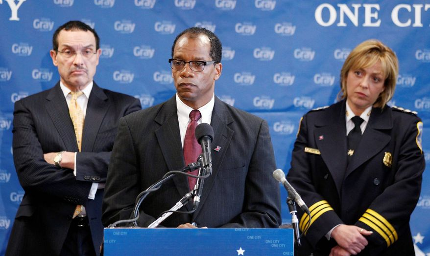 APPOINTMENTS: Kenneth B. Ellerbe, Mayor-elect Vincent C. Gray's choice as the District's next fire chief, answers questions Thursday as Mr. Gray and Police Chief Cathy L. Lanier listen. (Associated Press)
