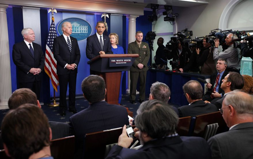 Associated Press President Obama discusses the Afghanistan-Pakistan annual review Thursday as (from left) Defense Secretary Robert M. Gates, Vice President Joseph R. Biden Jr., Secretary of State Hillary Rodham Clinton and Marine Gen. James Cartwright look on.
