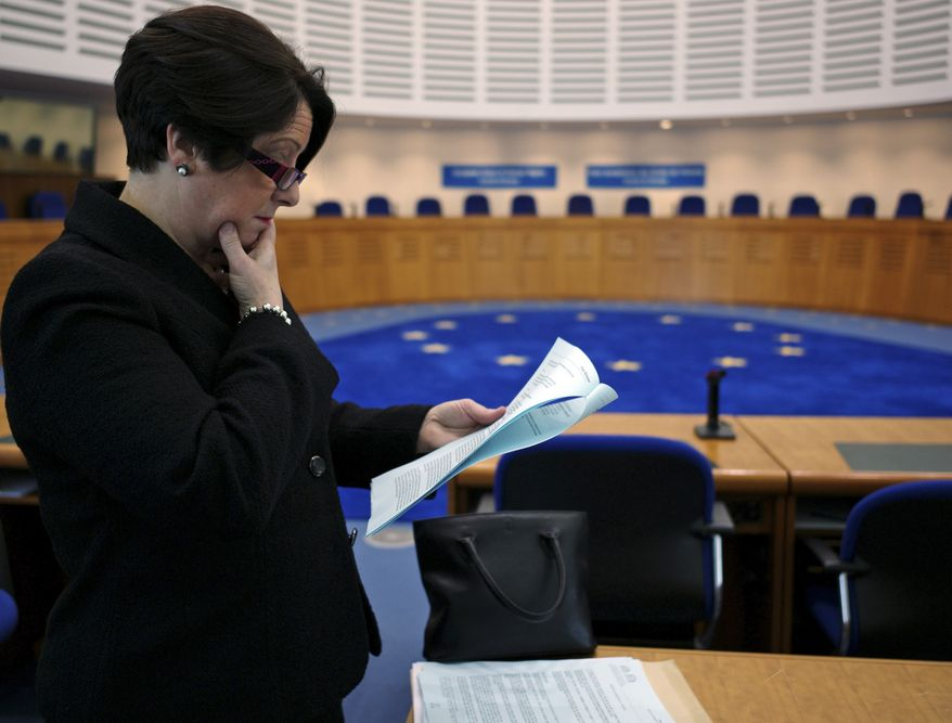 Carmel Stewart, a lawyer of the three women victims of restrictions on abortion in Ireland, reads the judgment from the European Court of Human Rights in the Grand Chamber Thursday Dec. 16, 2010, in Strasbourg, eastern France. Ireland's constitutional ban on abortion violates the rights of pregnant women to receive proper medical care in life-threatening cases, the European Court of Human Rights ruled Thursday in a judgment that harshly criticized Ireland's long inaction on the issue. (AP Photo/Christian Lutz)